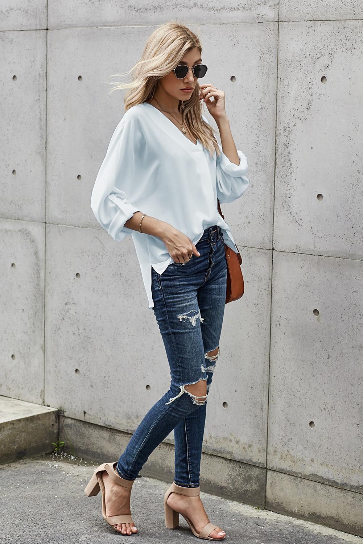 白色V领3/4袖高低下摆时尚宽松上衣 LC2511106