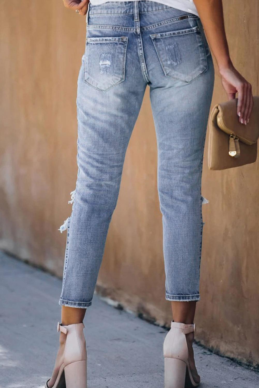 浅蓝色水洗仿旧破洞牛仔裤 LC78064