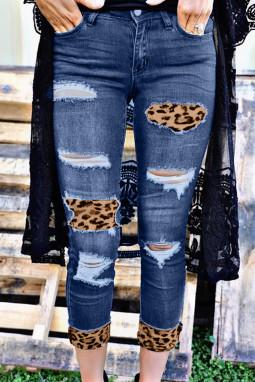 蓝色磨损仿旧豹纹补丁修身牛仔裤