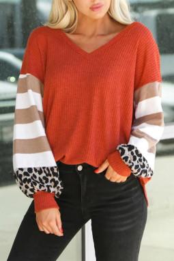橘红色V领灯笼袖豹纹条纹拼接长袖上衣