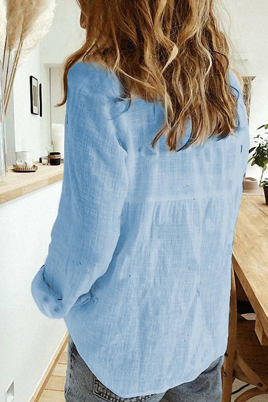 天蓝色排扣长袖简约女士衬衫 LC255378