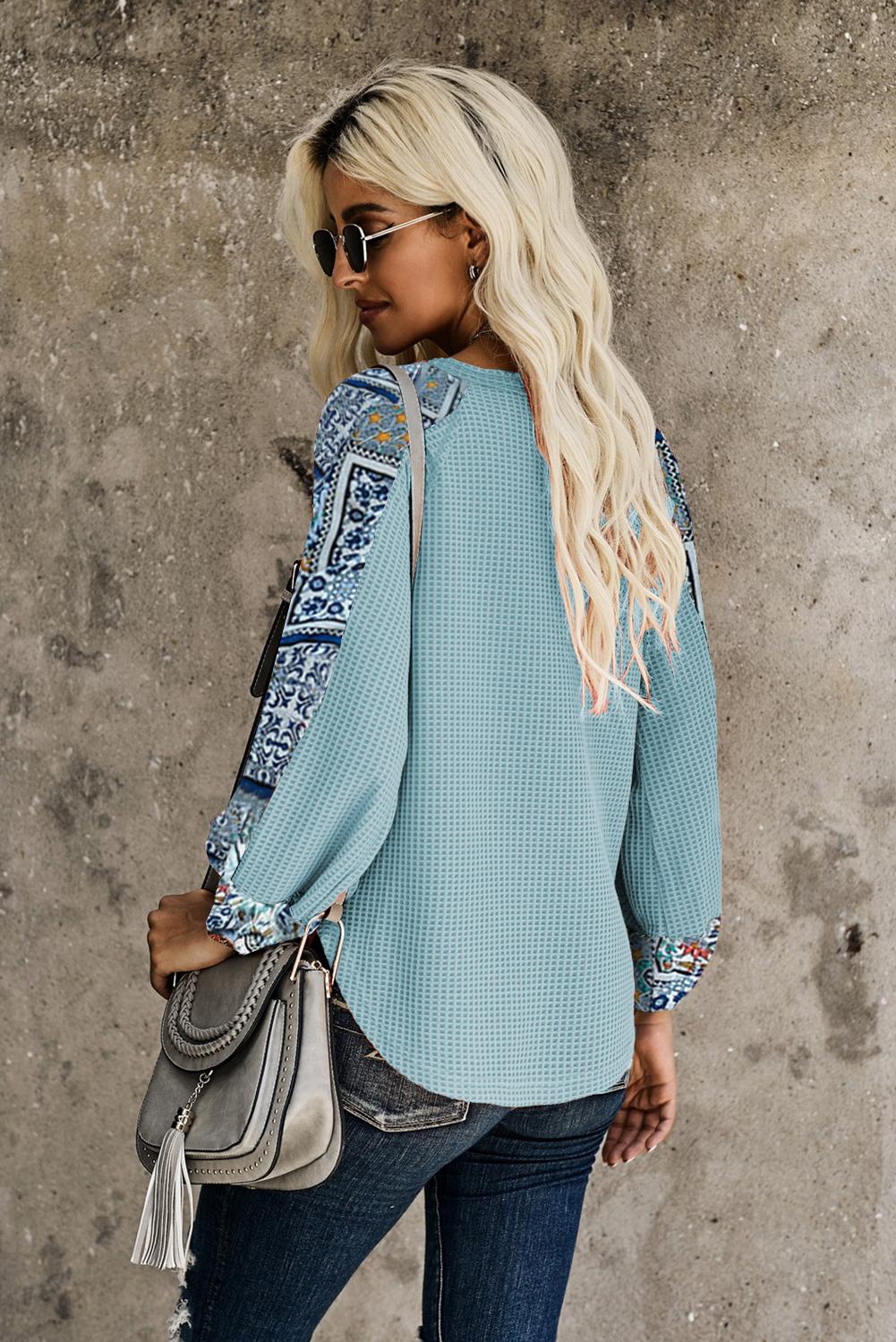 时尚印花拼接长袖天蓝色宽松保暖针织上衣 LC2511428