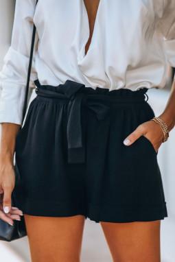 黑色宽松侧口袋时尚纸袋腰短裤