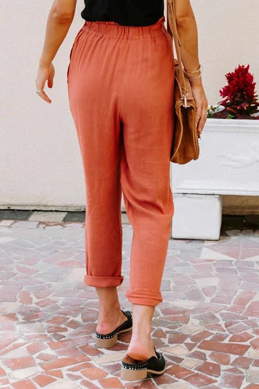 橙色亚麻混纺排扣装饰侧口袋纸袋腰休闲裤 LC77421
