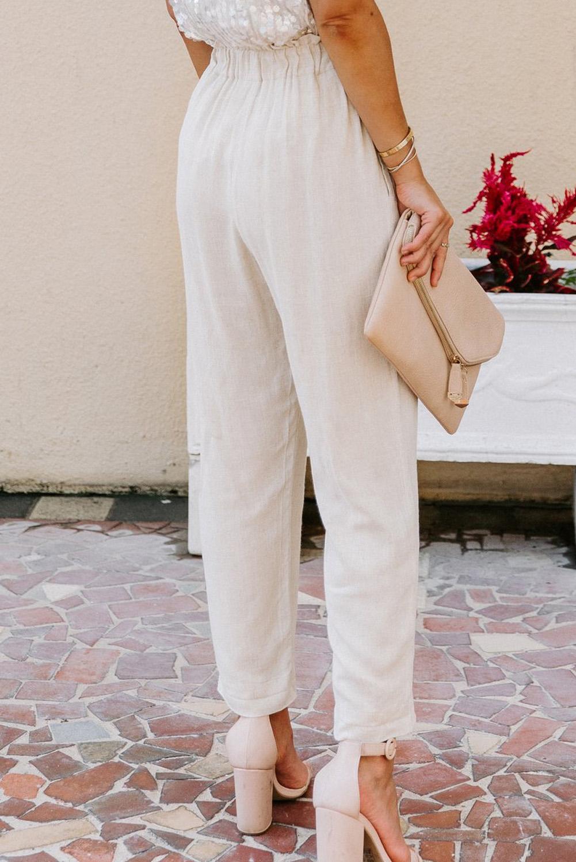 杏色亚麻混纺排扣装饰侧口袋纸袋腰休闲裤 LC77421