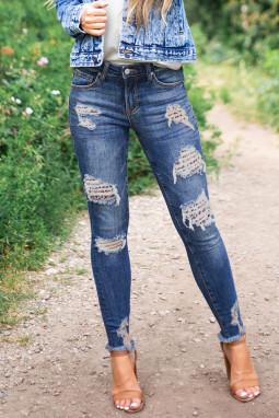 蓝色破洞豹纹补丁水洗修身牛仔裤