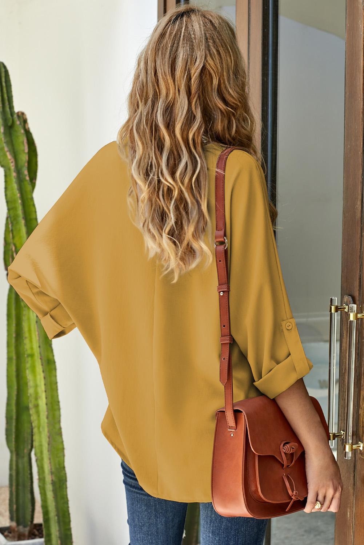 深黄色V领3/4袖高低下摆时尚宽松上衣 LC2511106